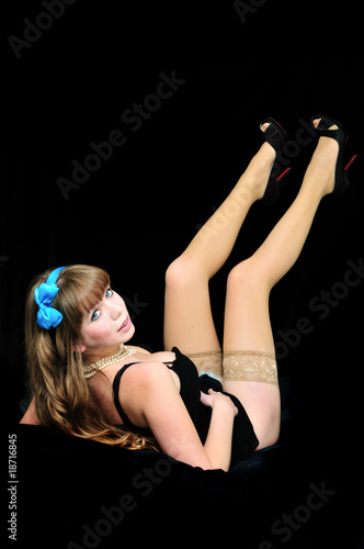 pin-up girl laying on the black