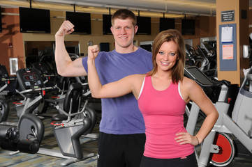 Man and Woman Flexing Arm