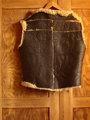 Winter leather vest on the old  wardrobe