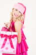 cheerful santa helper girl with shopping bags