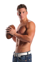 Muscular young man holding a football