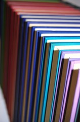 Row of coloured hardback books
