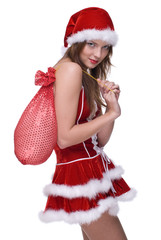 Closeup of girl in santa clause dress and gifts bag