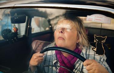 Senior woman in oldtimer car
