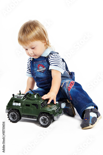 The little boy with a toy military vehicle