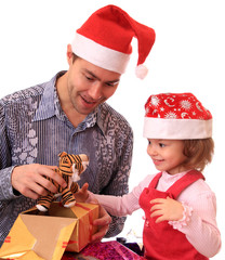 Dad with daughter open gifts.