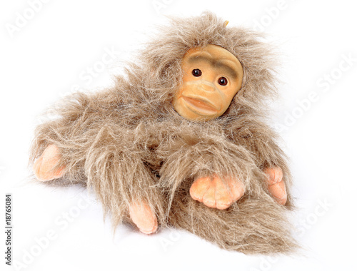 Toy ridiculous shaggy monkey isolated on  white background