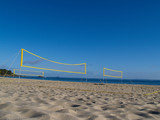 Beach Volleyball nets erected for play. poster