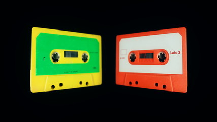 3d effect of old audio cassettes being flipped through