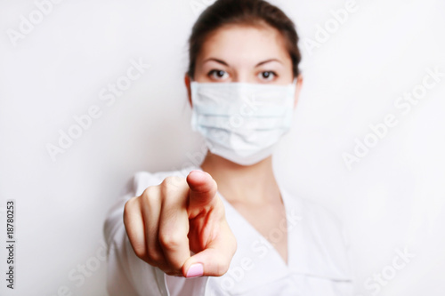 Portrait of the girl-doctor with a mask on the person.