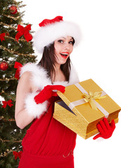 Christmas girl in santa hat and fir tree with gold  gift box.