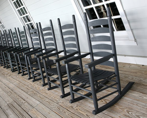 Rocking chairs lined up on the porch