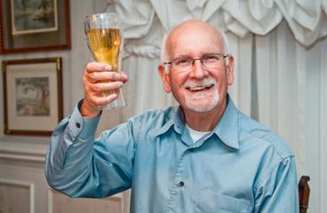 Happy senior man toasts retirement