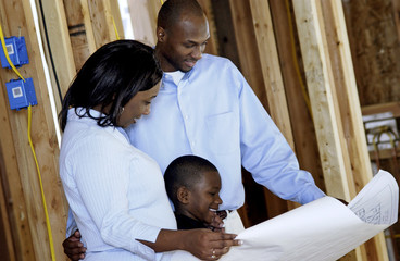 Family looking at their new home plans