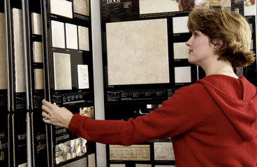 Woman looking at flooring samples
