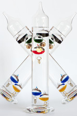Ornamental Galileo thermometers isolated over white