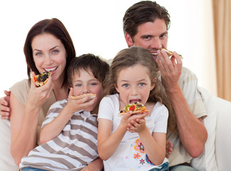 Happy family eating pizza