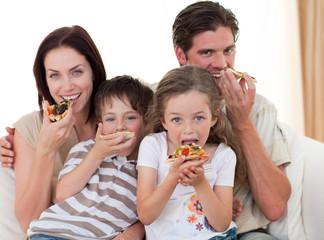 Happy family eating pizza