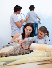 Young family renovating home after moving