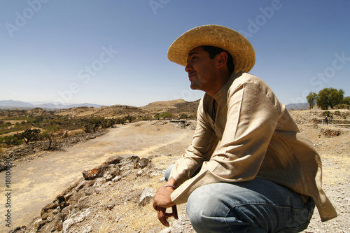 Handsome man with a hat, watching over the land, Mexico