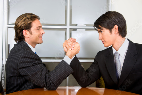 Business men arm-wrestling