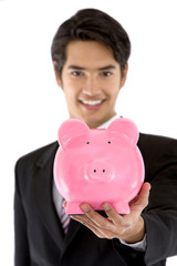 Business man with a piggybank