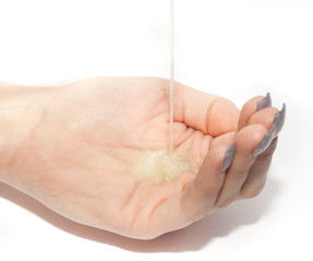 iquid Gel Soap Pouring  into a Womans Hand