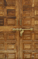 Old wooden door with a massive brass lock, Indian handicraft