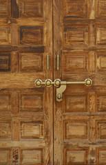 Old wooden door with a massive brass lock, Indian handicraft