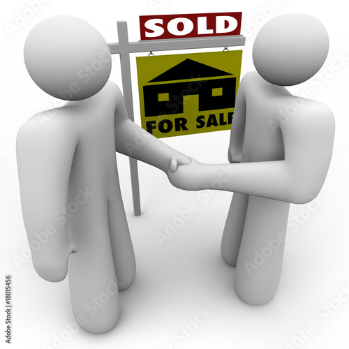 Buyer and Seller Handshake - For Sale Sign