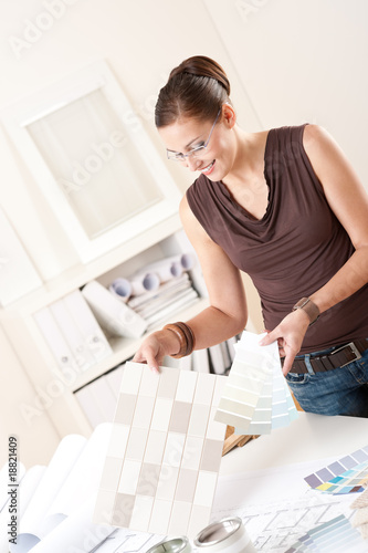 Female interior designer choosing color of tiles