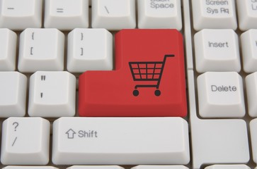 Keyboard with red shopping cart on a button.