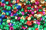 Different colored sequins for craft use poster