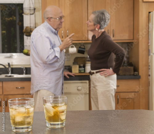 Senior couple drinking and arguing