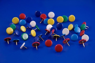 Colorful pushpin on a blue background