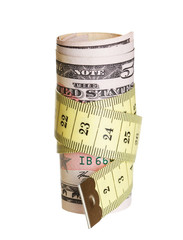 A dollars  with a tape measure wrapped around.