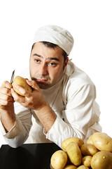 bored chef peeling potatoes