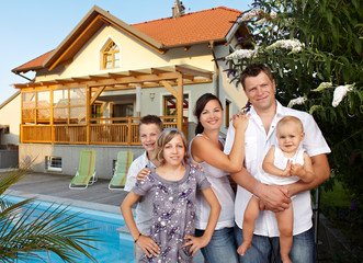 Young proud family with pool and house