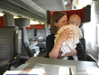 Mother Holding Baby on Train