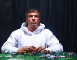 a poker player sitting at a table