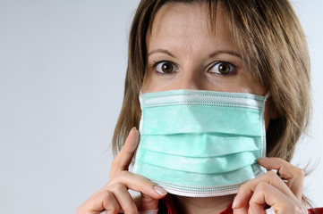 woman with mask against flu paranoia