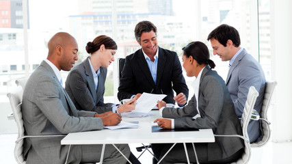 Multi-thnic business team discussing a new strategy