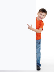 little boy pointing on the blank poster
