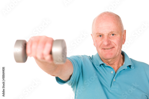 Mature older man lifting weights