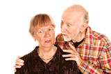 Senior man sharing information with concerned wife poster