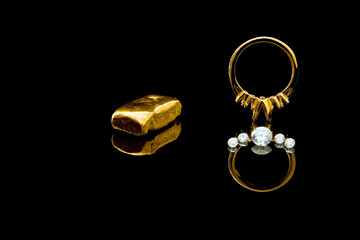 An unmounted gold ring with diamonds ready for setting