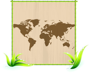 world map on scratched paper in green bamboo picture frame