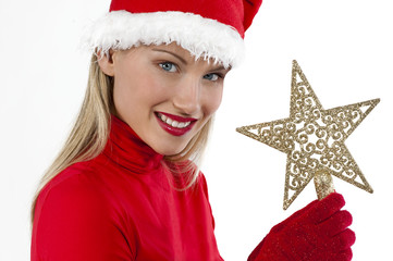 Beautiful Santa girl on white holding a Christmas star
