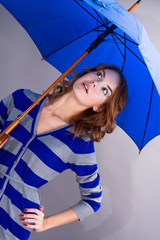 The girl under a dark blue umbrella