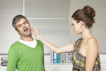 Woman slapping man's face